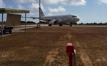 The charter plane on Christmas Island waiting to take the New Zealand detainees home tomorrow.