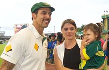 Australia's Mitchell Johnson and his family farewell the crowd as he retires from test cricket.