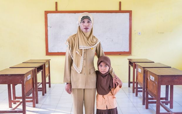 "31 year old teacher school teacher Ibu Ratna is HIV positive, ""Although I am HIV positive my colleagues at school continue to give me support."""
