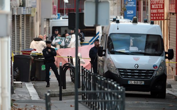 Riot police and forensics teams outside the Saint-Denis building raided by police on Wednesday.