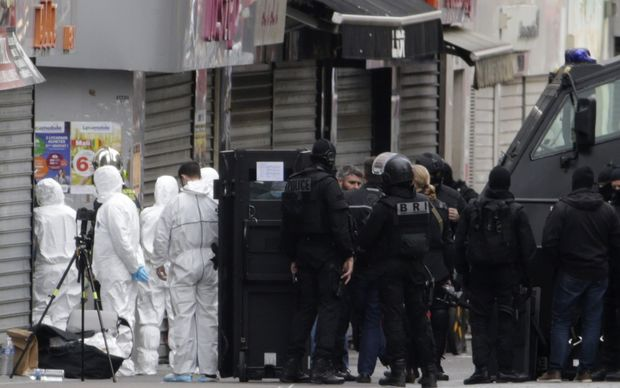 Police and forensics teams in Saint-Denis after the raids.