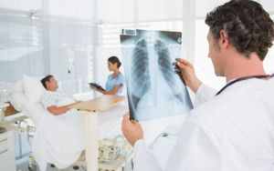 Doctor checking X-Ray in hospital (generic).