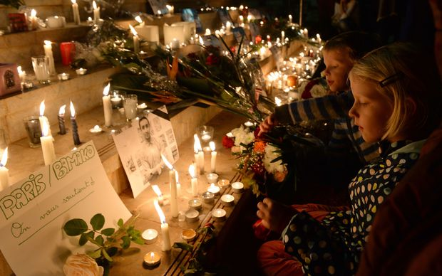 People gather for a candlelight vigil in Rabat, Morocco, in solidarity with victims of the attacks in Paris.