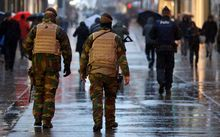 Police and military officers patrolling in central Brussels on Saturday.