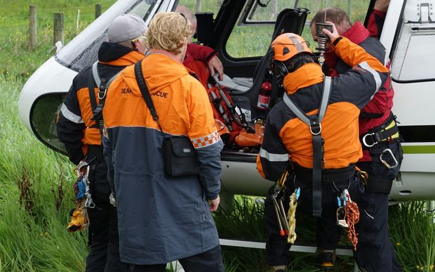 The alpine cliff recovery team prepare to fly into Fox glacier.