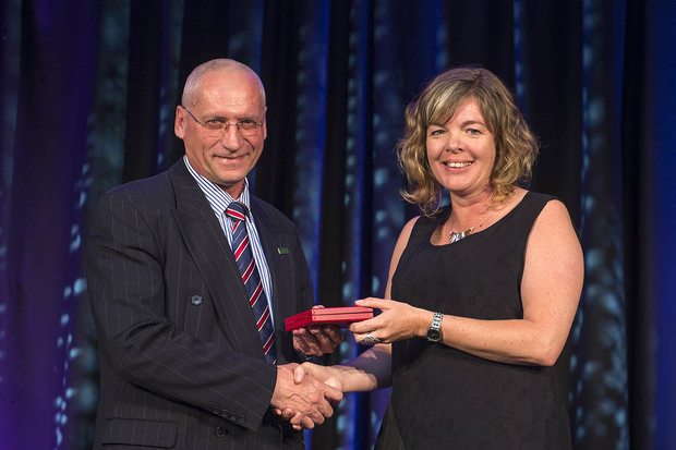 Professor Valery Feigin receiving his McDiarmid  medal from Professor Juliet Gerrard at the 2015 Royal Society of New Zealand Research Honours dinner