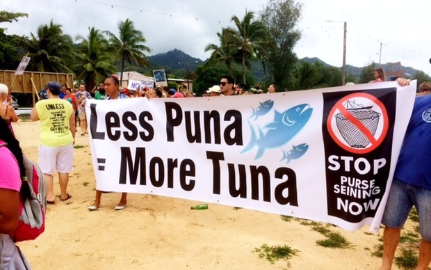 Cook Islanders march to decry the Prime Minister Henry Puna and his government's deal with the European Union on purse seine fishing.