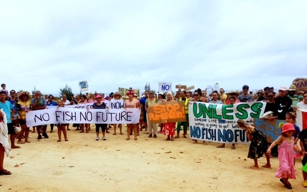 A group marching against the Cook Islands fish deal with the EU