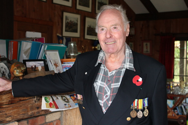 Former international airline pilot Nicholas Murray Leslie now produces tea tree oil.He is wearing his service medals standing in his lounge at home in Whitianga.