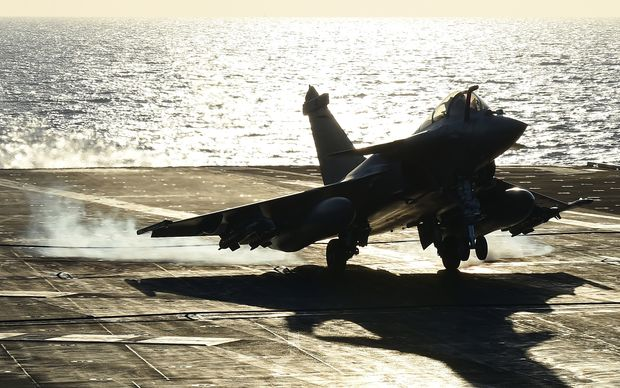 A warplane landing on French aircraft carrier Charles de Gaulle as part of an operation to strike Islamic State targets in Syria.