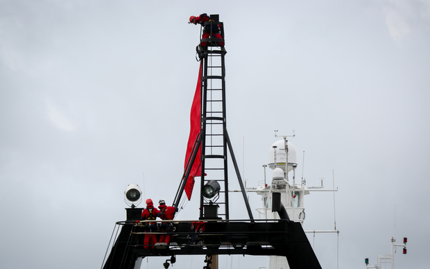 Greenpeace activists on board the government research ship Tangaroa in Wellington.