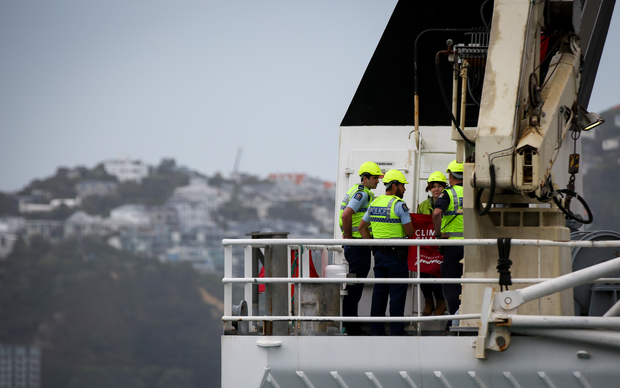Police on board the Tangaroa, the research ship boarded by Geenpeace activists in a protest over oil exploration.