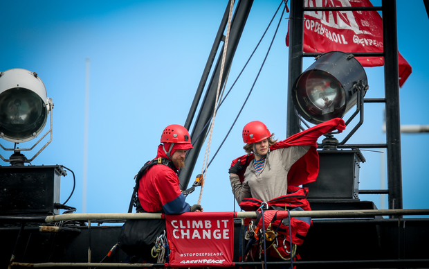 Greenpeace activists have put more layers on board the government research ship Tangaroa in Wellington.