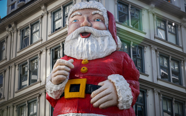 Large santa statue mounted to a building in Auckland's central city.