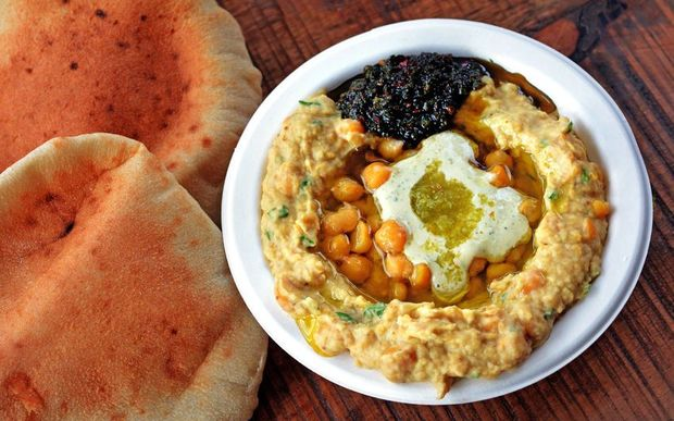 Hummus with olive oil, herbs, pitta bread and spices.