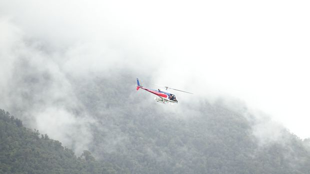 Rescue helicopter attends to the last three fatal crash victims on Fox Glacier.