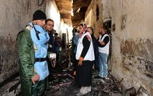 November 10 ,2015, an Afghan (L) talks to staff members in a charred corridor of the damaged Medecins Sans Frontieres (MSF) hospital in northern Kunduz. On October 3, 2015 US forces bombed the MSF Hospital in northern Kunduz, killing at least 30 people.