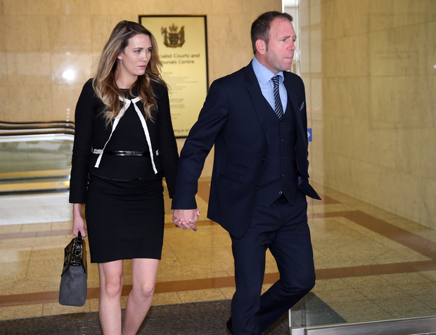Ex-Megaupload executive Finn Batato and his wife Anastasia leave court for lunch in Auckland on 21 September 2015.