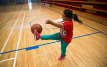 Aiga Lama playing with a basketball at the indoor courts at Otara Pool and Leisure Centre.