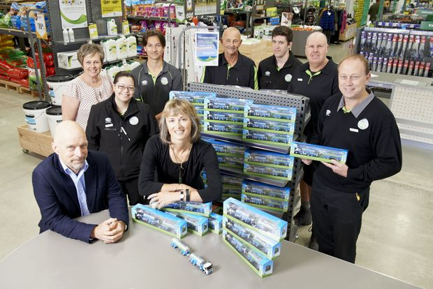Matt Shirtcliffe (Executive Creative Director, Shirtcliffe & Co - bottom left), Shelley Creswell, Fonterra Farm Source (top left), Michelle Thompson (Chief Executive, RHĀNZ - bottom right) and staff with the mini tankers at the Fonterra Farm Source Store in Cambridge.