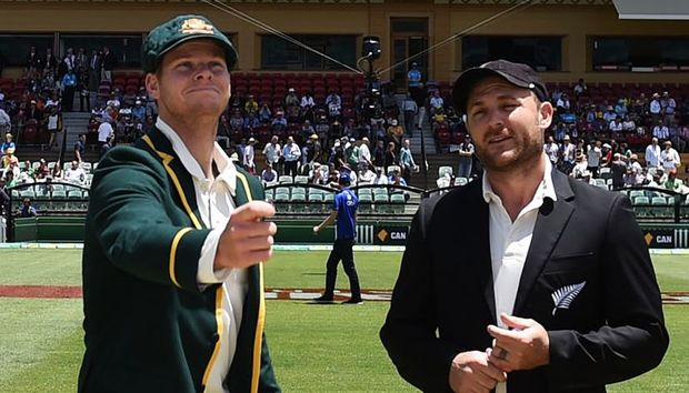 Captains Steve Smith (Australia) and Brendon McCullum (New Zealand) make the toss in the inaugural day-night cricket test,