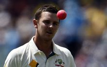 Australia's paceman Josh Hazlewood tosses a pink ball as he gets ready to bowl during the first day-night cricket Test match at the Adelaide Oval on November 27, 2015.