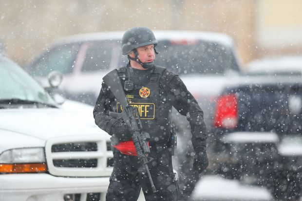 A member of the Colorado Springs sheriff's department secures the scene during an active shooter situation near a Planned Parenthood facility where an unidentified suspect has reportedly injured up to nine people, including at least four police officers, on November 27.