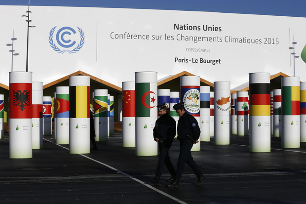 Policemen walk past the conference centre of the United Nations Conference on Climate Change COP21 in Le Bourget, north of Paris.