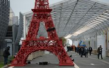 A replica of the Eiffel Tower built from bistrot chairs is installed at the COP21 climate summit's venue at Le Bourget, northeast of Paris.