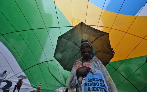 A woman takes part in the Global Climate March in Sao Paulo, Brazil.