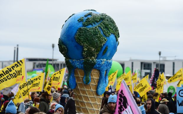A melting planet in an ice cream cone carried during the climate change march in  Berlin, Germany.