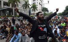 Papuan pro-independence demonstrators stage a protest in Jakarta on December 1, 2015, before police fired tear gas at a hundreds-strong crowd hurling rocks during a protest against Indonesian rule over the eastern region of Papua.