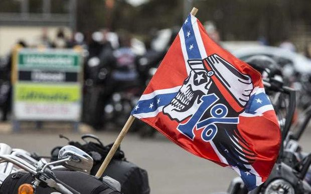 Rebels motorcycle gang flag and bikes, Australia.