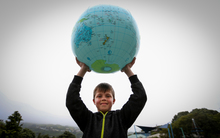 9 year old Brodie Murdoch from Hamption Hill Primary School holds up the world.