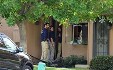FBI agents investigate at a townhome in Redlands, California, which is linked to the shooting rampage in San Bernardino.
