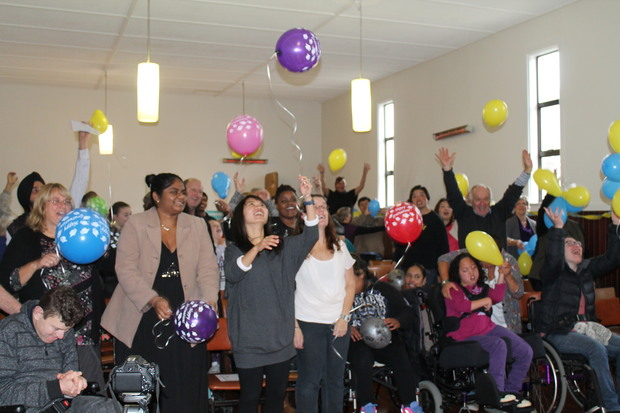 A photo of families and carers celebrating at the STARS Graduation Ceremony.