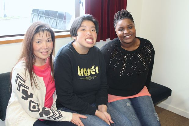 A photo of Tansy Ken, her daughter, Jennifer and a trainee carer, Nelta Jachi.