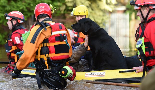 Members of the emergency services rescue residents and thier dogs in Carlisle on December 6, 2015.