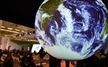 People visit the American display at COP21, the United Nations conference on climate change at Le Bourget.