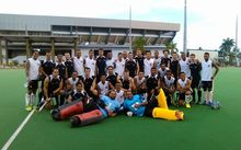 Fiji and New Zealand hokcey teams pose after their match at an invitational tournament in Suva.