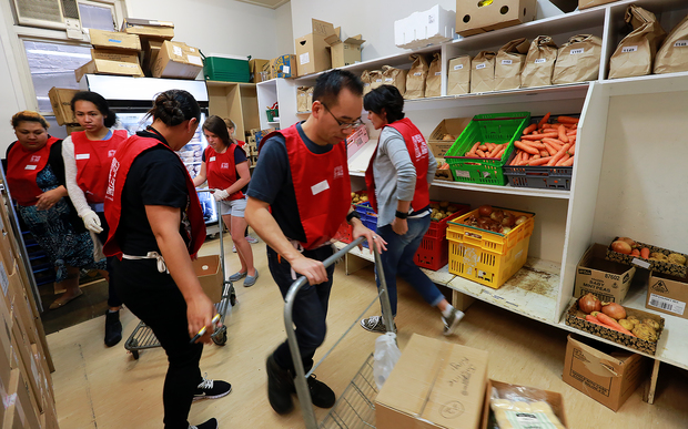Volunteers help prepare the special Christmas parcels at Auckland's City Mission