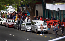 A crowd gathers outside City Mission in central Auckland, waiting for the special Christmas parcels.