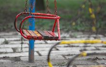 Rusty swing in playground