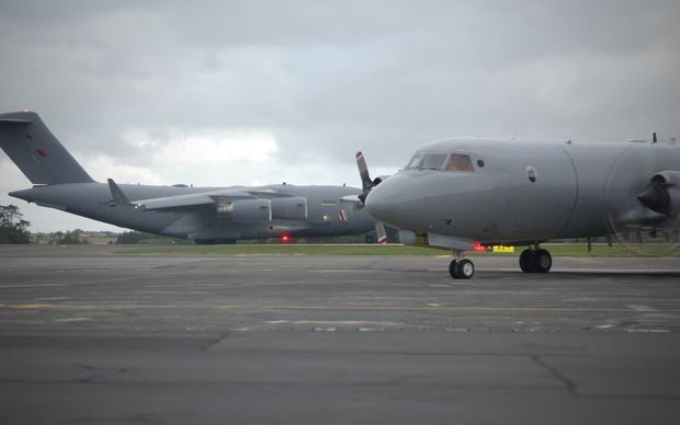 The RAF C-17 Globemaster from the UK and the RNZAC P-3K2 Orion land at Whenuapai Air Base in Auckland.