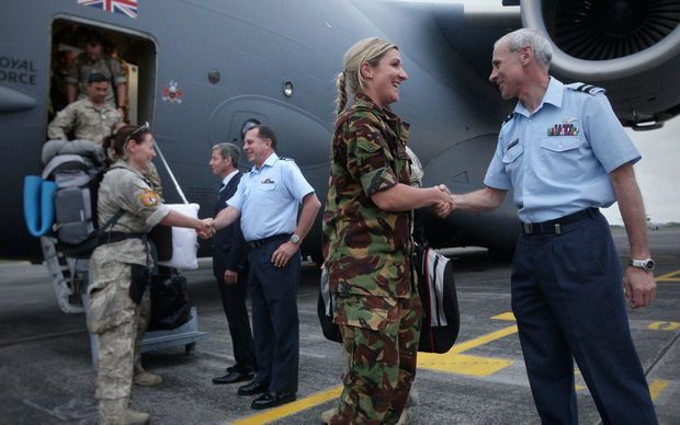 Personnel being welcomed back to New Zealand after stepping off the plane.
