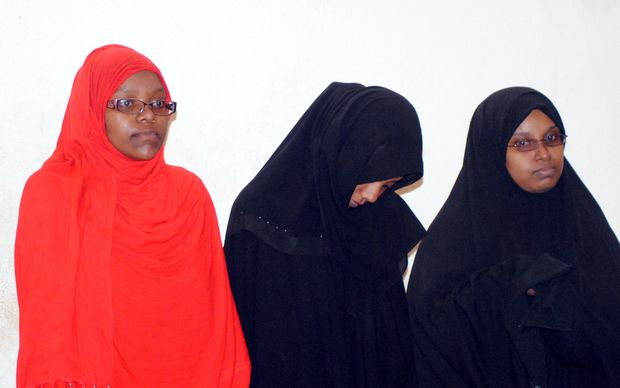 Three women brought before a court in Kenya's coastal city of Mombasa on March 30, 2015 after having been arrested by security forces at the border with Somalia for allegedly planning to travel to Syria. Yassin Juma / Anadolu Agency