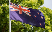The current New Zealand flag flies up a flag pole.
