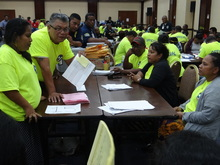 Marshall Islands Chief Electoral Officer Robson Almen (holding paper) talks to tabulators during the late November ballot counting in Majuro in 2015.