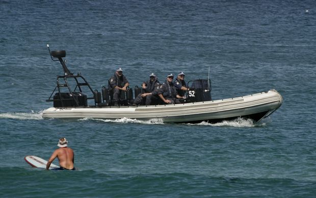 Armed police patrol off Cronulla Beach in after race riots erupted in the Sydney suburb in December 2005.