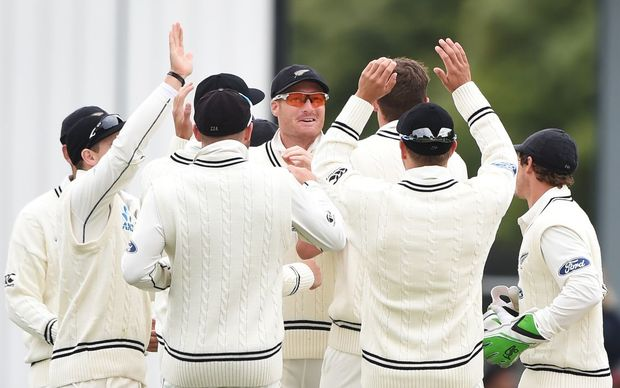 Martin Guptill and team-mates celebrate the dismissal of Chandimal during day 3 of the 1st cricket test match between New Zealand Black Caps and Sri Lanka at University Oval, Dunedin, New Zealand. Saturday 12 December 2015. Copyright photo: Andrew Cornaga / www.photosport.nz